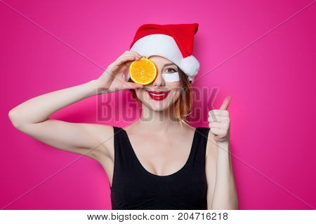 Woman Using Eye Patch For Her Eyes In Santa Claus Hat With Orange