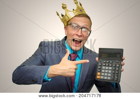 Funny mad accountant with calculator in hands and golden crown above his head. Submission of the annual report. Finacial results. Stock market trader profit. Winner.