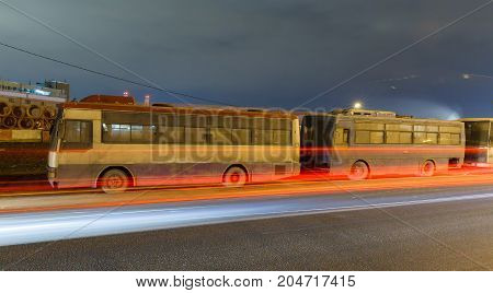 abandoned transport metropolis, traffic and blurry lights of cars on the highway and multiband dense road traffic at night in Moscow