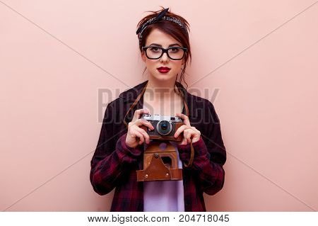 Young Redhead Girl In Bandana Holding Vintage Camera