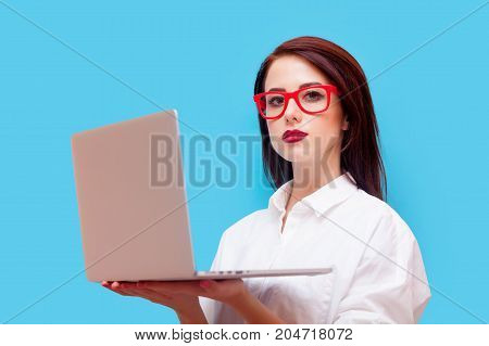 Young Redhead Businesswoman Holding Laptop Computer
