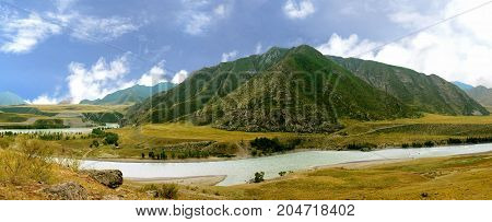 Panoramic view of the picturesque landscape of the mountains in the Altai region and a winding river nearby. Siberia. Russia