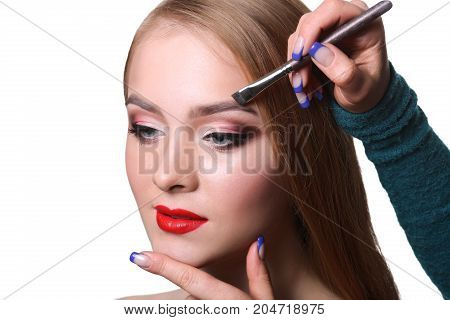 Eyebrow shadow applying, brow modelling makeup closeup. Female model face with fashion make-up, beauty concept isolated