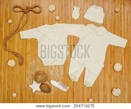 Children's Clothing With Toys On A Wooden Background