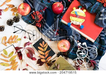Clock With Glasses And Mobile Phone On Red Book ,education Concept, Mobile Phone With Headphones, Au
