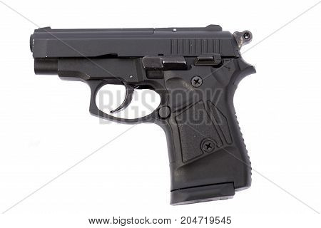 A loaded black handgun on white background
