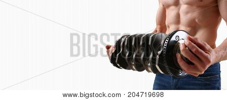 Strong Male Hands Hold The Crankshaft On A Gray Background