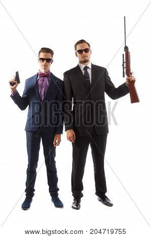 Two men in suits holding guns on white background