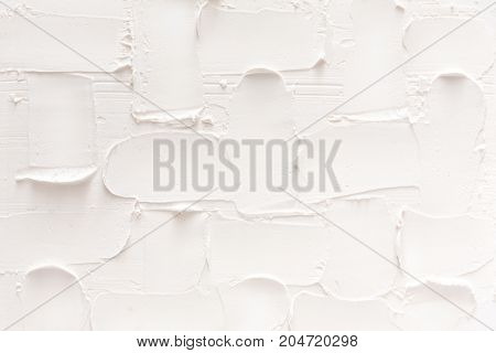 Textured white brick wall, stucco pattern. Abstract background, plaster decorative pattern, interior design, construction concept