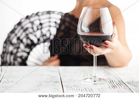 Woman Hold Glass  Red Wine And Call To Drink With Her