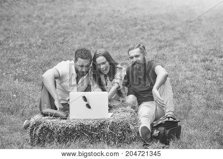 friends people pretty girl and handsome men use laptop computer outdoors on natural background