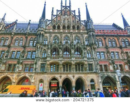 Munich, Germany - May 02, 2017: The people going near famous old Munich city hall at Germany on May 02, 2017