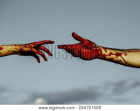 Halloween Hands With Red Blood On Grey Sky Background
