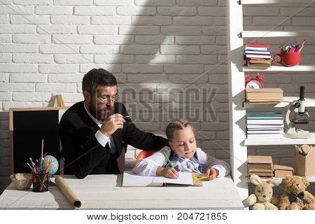 Girl And Father In Study Room On White Brick Background