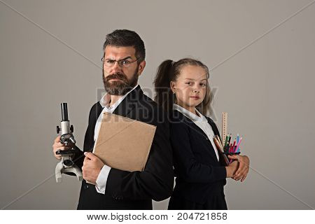 Girl And Man In Suit, School Uniform. Father And Schoolgirl
