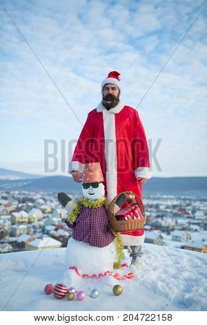 Man Standing With Snowy Sculpture On Cloudy Sky