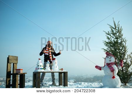 Hipster Enjoying Winter Day On Blue Sky