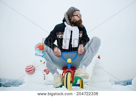 Hipster In Pilot Glasses And Hat On Bike