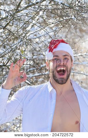Man In Santa Hat And Open Shirt Showing Ok Hand