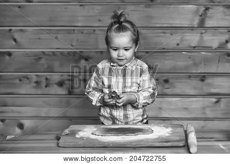 Cute Child Cooking With Dough And Flour, Holds Metallic Mold