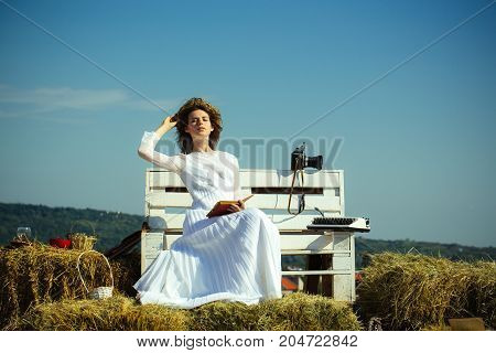 Woman Reading Book On Blue Sky