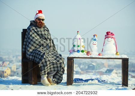 Hipster In Plaid Blanket Sitting On Chair On Winter Day
