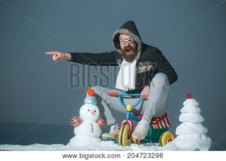 Excited Man Riding Tricycle On Grey Sky
