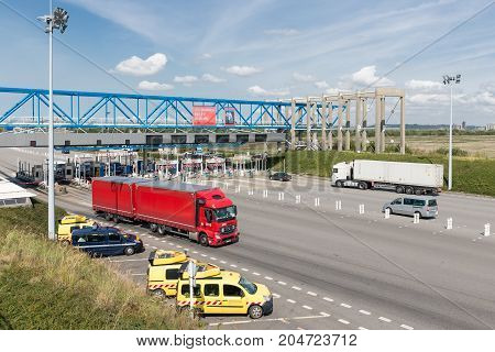 LE HAVRE FRANCE - AUGUST 24 2017: Toll station with passing cars for bridge Pont de Normandie over river Seine