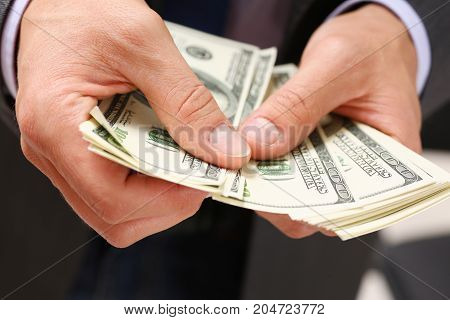 Man Hold In Arm Pack Of Hundred Dollar Bills