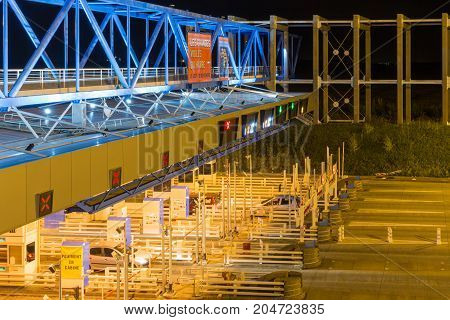 LE HAVRE FRANCE - AUGUST 25 2017: Night shot of toll station with passing cars for bridge Pont de Normandie over river Seine