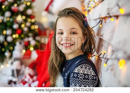 Happy student in a sweater. The concept of Merry Christmas New Year family.