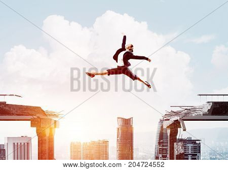 Business woman jumping over gap in concrete bridge as symbol of overcoming challenges. Cityscape with sunlight on background. 3D rendering.