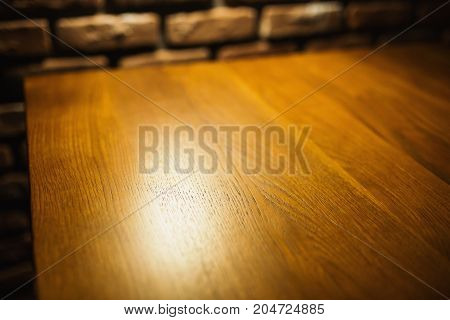 Wooden table background with warm light. Wood background. Brown background. Old tree background. Background of the table in the restaurant. Background of a natural wooden surface