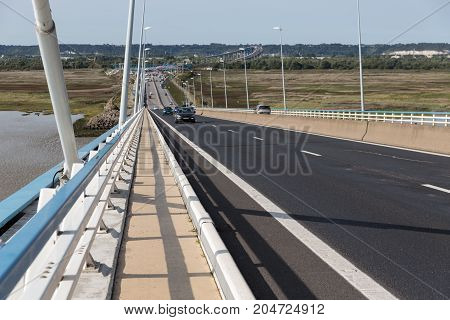 Climbing highway at Pont de Normandie French bridge over river Seine