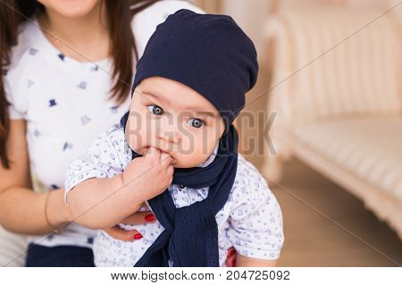 Child, childhood and infant concept - close-up of happy little baby boy at home.