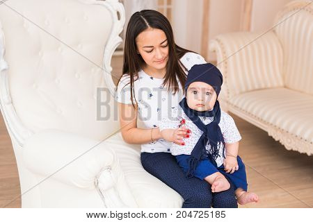 Portrait of a cute baby boy sitting and smiling. Adorable four month old child