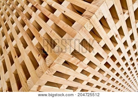 Detail of a cubic wood structure: many pieces joined together that form a system...a team