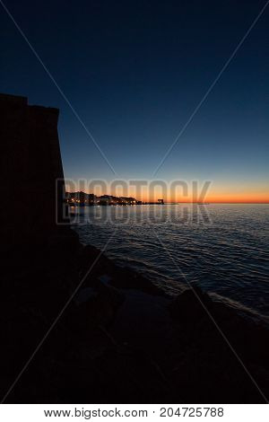 Sunset on the sea from the sicilian coast of Trapani with