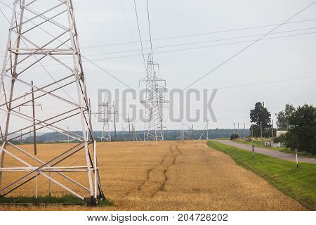 Power towers against the sky. Transmission of electricity by wire. Electricity of the wire. Electricity line. To conduct electricity by wire