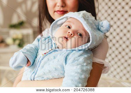 Portrait of a little adorable newborn infant asian baby.