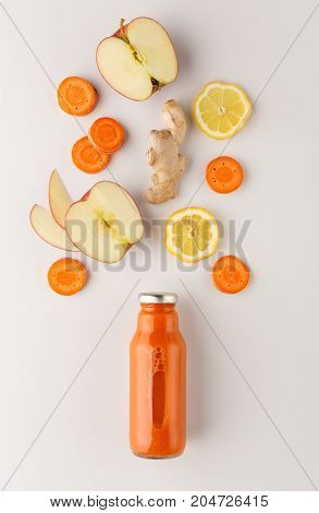 Healthy food. Detox smoothie with ingredients, fruits and vegetables, on white background, top view, copy space.