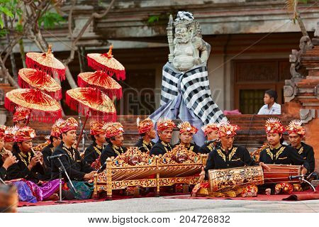 BALI INDONESIA - June 20 2015: Musicians of Gamelan orchestra in Balinese people costume playing ethnic ritual music on traditional Indonesian instruments.