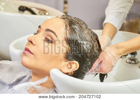 Female getting her head washed. Person in beauty salon.