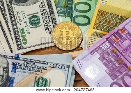gold bitcoin with dollar and euro banknote