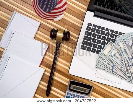 Gavel With Laptop, Dollar, Notepad And Flag
