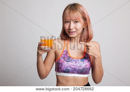 Beautiful Asian Healthy Girl Point To Orange Juice.
