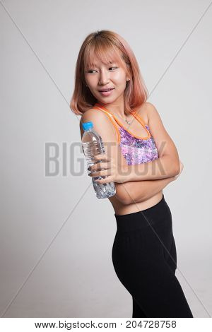 Beautiful Asian Healthy Girl With Bottle Of Drinking Water.
