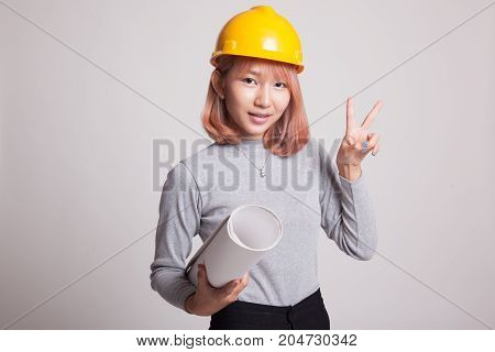Asian Engineer Woman With Blueprints Show Victory Sign.