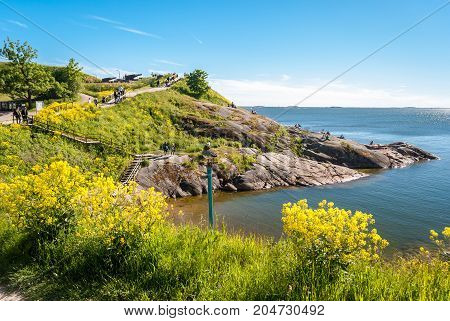 Rocky coastline in the island of Suomenlinna Helsinki during a summer afternoon.