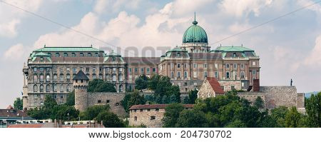 Image of the Buda Castle, or also called Royal Palace or Royal Castle in Budapest in Hungary on a beautiful day with blue sky and a few clouds.